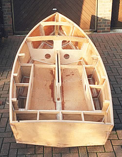 Plans: http://www.heron-dinghy.org.uk/
