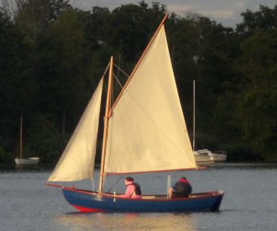 The nice swampscott dory by Selway Fisher might be able to use a simpler sail - reallysimplesails.com